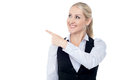 Lady pointing towards copy space area experienced female executive away Stock Photography