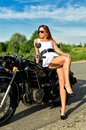 Lady posing on motorcycle Royalty Free Stock Photo