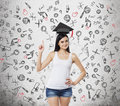 Lady is presents a necessity of higher education graduation hat above her head educational icons are drawn over the con brunette Stock Images