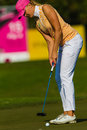 Lady Pro Golfer Putting Colors Royalty Free Stock Image