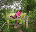 Lady Rambler climbing over a Stile Stock Photos