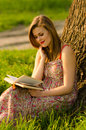 Lady Reading Book In The Nature