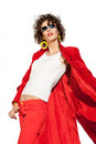 Lady in red beautiful brunette sunglasses and coat on white background Royalty Free Stock Images