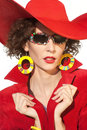 Lady in red close up portrait of beautiful fashionable woman hat and stylish sunglasses Royalty Free Stock Photography