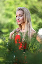 Lady in red outdoors blond park Royalty Free Stock Image