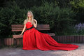 Lady in red outdoors park Stock Photo