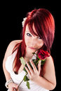 Lady with rose a beautiful red haired girl holding a red Royalty Free Stock Photos