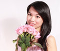 Lady and rose a beautiful sweet asian holding a bunch of roses Stock Photos