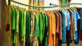 Lady s fashion shop colourful national costumes on racks interior view of clothing hongkong china asia Stock Photo
