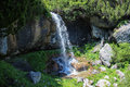 Lady s waterfall bucegi cascada doamnei bucegi in mountains romania at the beginning of summer it a small piece of heaven Royalty Free Stock Photo