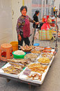 A lady selling various types of dried fish product at tai o fishing village hong kong Stock Photo
