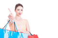 Lady shopper being serious and making wait or stay gesture Royalty Free Stock Photo