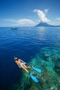 Lady snorkeling over reef wall in the area of the island of bunaken sulawesi indonesia Stock Images