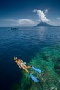 Lady snorkeling over reef wall in the area of the island of bunaken sulawesi indonesia Royalty Free Stock Image