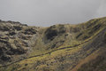 Lady of snowdon the face profile feature on the flank a steep hill in snowdonia near llanberis gwynedd wales uk Royalty Free Stock Photo