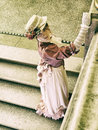 Lady on the stairs Royalty Free Stock Photo