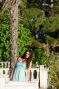 Lady standing on veranda of a beachfront home beautiful wearing long blue dress having great time her summer holidays Royalty Free Stock Photography