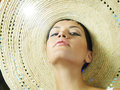 Lady in straw hat Stock Photography
