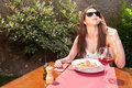 Lady with sun glasses enjoying lunch on terrace young wine outside copy text space area Stock Photos