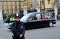 Lady thatcher s funeral policemen guarding peaceful journey for car with coffin leaving the house of parliament big ben before and Royalty Free Stock Photos