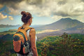 Lady tourist with backpack standing on top of mountain Royalty Free Stock Photography
