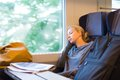 Lady traveling napping on a train blonde casual caucasian while by Royalty Free Stock Images