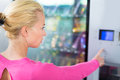 Lady using a modern vending machine Royalty Free Stock Photo