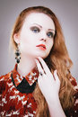 Lady vamp sensual fashion portrait of redhead girl with long hair Royalty Free Stock Images