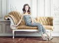 Lady in the vintage interior young beautiful on sofa Stock Photo