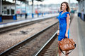 Lady waiting train on the railway station Royalty Free Stock Photography