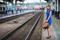 Lady waiting train on the railway station Stock Photography