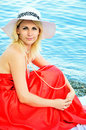 Lady wearing red dress on the beach Royalty Free Stock Image