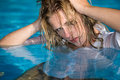 Lady with wet hair in pool Stock Photography