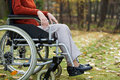 Lady on wheelchair in the forest getting rest Royalty Free Stock Photo