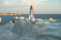 Lady in white dress in an unusual landscape Royalty Free Stock Photo