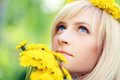 Lady with yellow flowers closeup portrait of pretty young in a park outdoor Stock Image