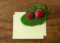 Ladybird and paper cobblestone on old wooden table Royalty Free Stock Photography