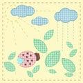 Ladybug in leaves. Plaid textile applique