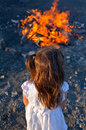 Lag baomer jewish holiday little girl stand beside bonfire celebrate Royalty Free Stock Photo