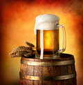 Lager on barrel glass of and wheat a wooden Stock Photography