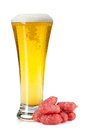 Lager beer glass and mini sausages isolated on white background Stock Photos