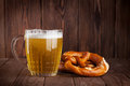 Lager beer glass and pretzel
