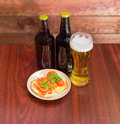 Lager beer and sandwiches with the salted trout Royalty Free Stock Photo