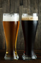 Lager and dark beer on wood close up Royalty Free Stock Photography