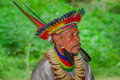 LAGO AGRIO, ECUADOR - NOVEMBER 17, 2016: Close up of a Siona shaman in traditional dress with a feather hat in an