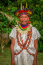 LAGO AGRIO, ECUADOR - NOVEMBER 17, 2016: Siona shaman in traditional dress with a feather hat in an indigenous village