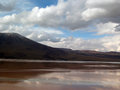 Laguna bolivia altiplano near uyuni snowcapped volcano background Royalty Free Stock Image