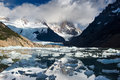 Laguna torre with ice pieces in the lake cerro mountain is covered in clouds Stock Photos