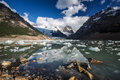 Laguna torre view point with ice pieces in the lake and the reflection cerro s peak is covered in clouds Stock Photo