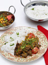 Lahore style curry vertical pakistan lamb and chana dhal split pea garnished with sliced chillies and chopped tomato and served Stock Photo